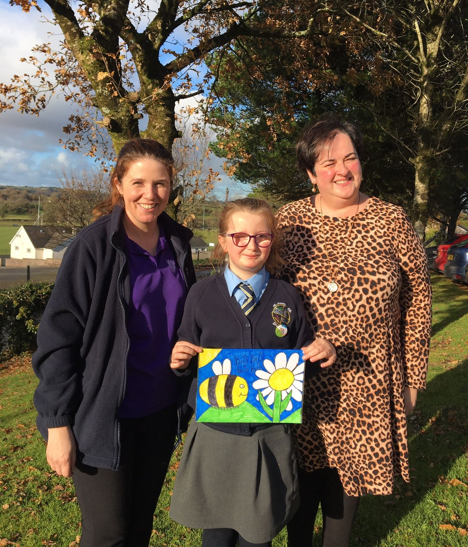 Pictured with her teacher, Geraldine Campbell and Julie Corry, Biodiversity Officer, Fermanagh and Omagh District Council, is Lucy Connolly from St. Joseph's PS, Drumquin who was one of 10 winners from across the District in the Trees for Bees art competition.